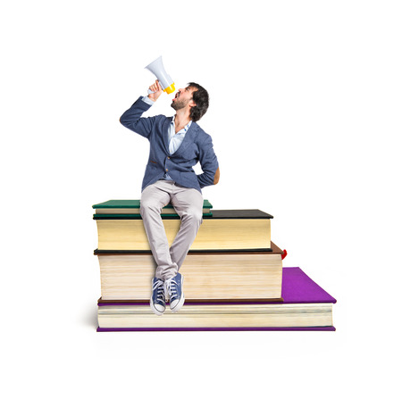 Man shouting on book photo