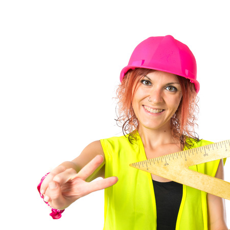 bevel: Worker woman with bevel over white background
