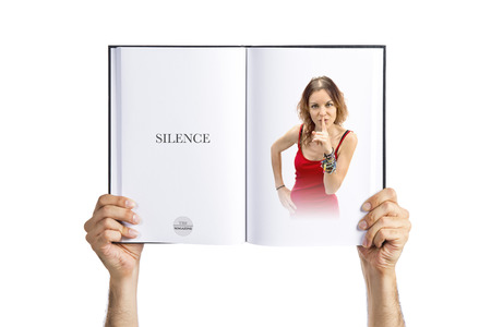 Young girl doing silence gesture photo
