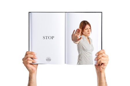 Pretty woman making stop sign  printed on book photo