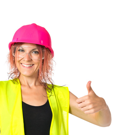 woman handle success: Worker woman with hacksaw doing good signal Stock Photo