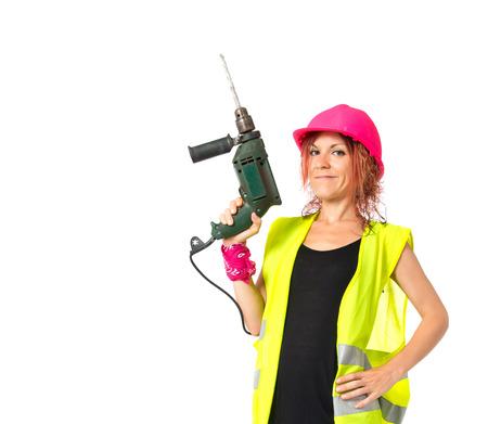 mujer trabajadora: Mujer del trabajador con el taladro sobre fondo blanco