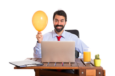 attractive office: Businessman in his office playing with balloon Stock Photo