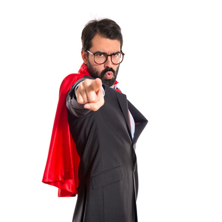 Businessman dressed like superhero pointing to the front photo