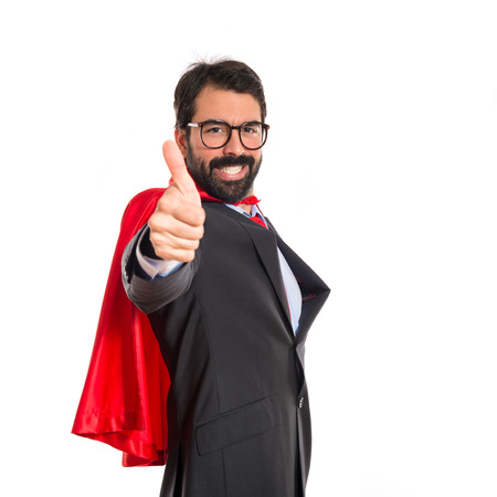 Businessman dressed like superhero with thumb up photo