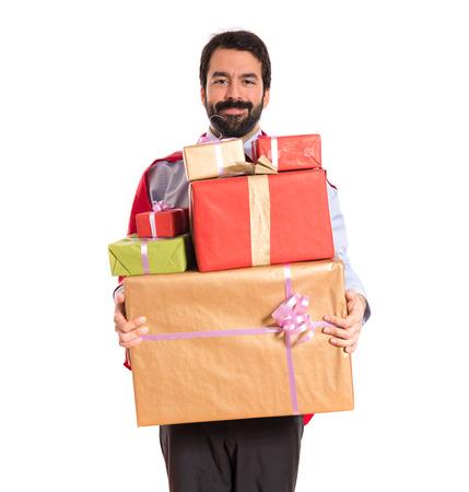 Businessman dressed like superhero holding gifts photo
