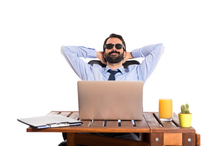 Businessman in his office with sunglasses photo