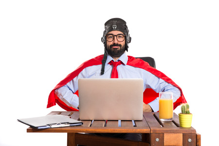 Businessman in his office with pilot hat Stock Photo