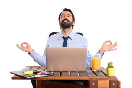 Businessman in his office  in zen position Standard-Bild