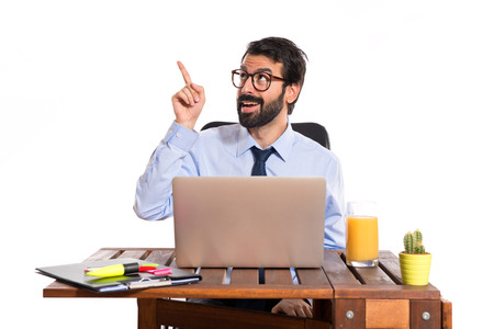 Businessman in his office thinking over white background photo