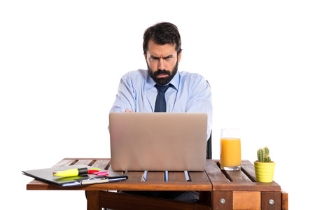 Sad Businessman working with his laptot