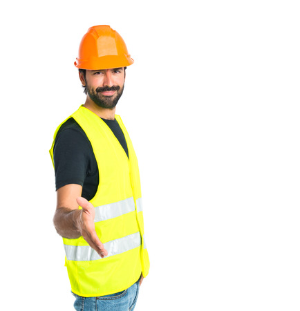 deal making: Workman making a deal over isolated white background Stock Photo
