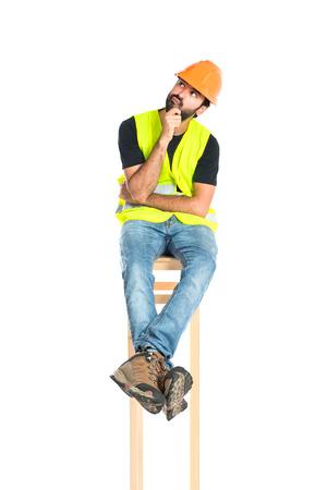 Workman thinking over isolated white background Stock Photo