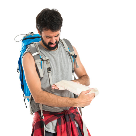 injure: Backpacker healing a wounded over white background