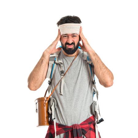 head injury: Adventurer with head injury over white background
