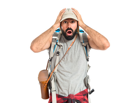 Backpacker doing surprise gesture over white background photo