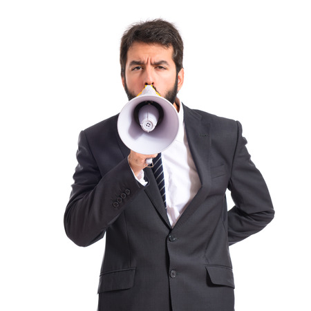 Businessman shouting over isolated white background photo