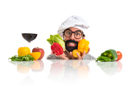 Crazy hipster chef playing with vegetables photo
