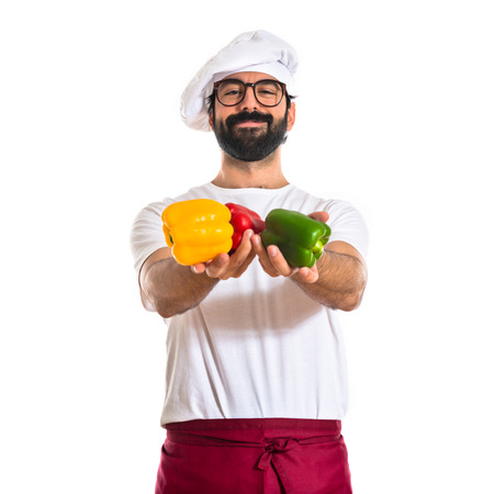 Chef holding colorful peppers photo