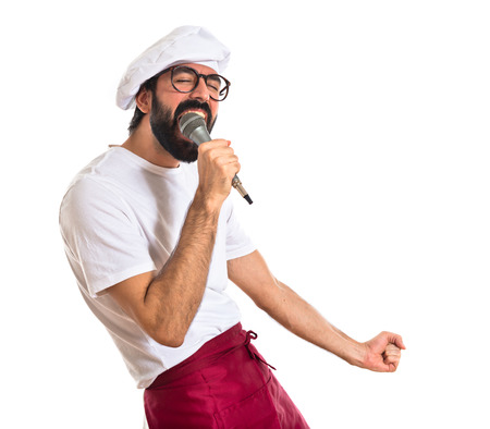 Chef singing over white background photo
