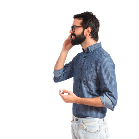 Young hipster man talking to mobile photo