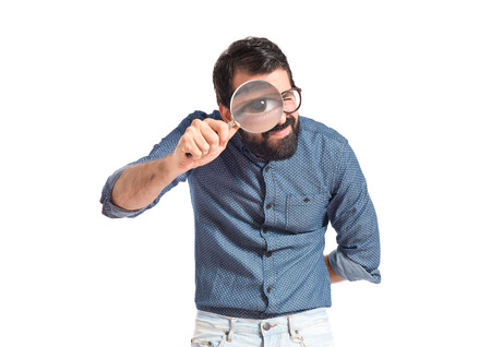 find glass: Young hipster man with magnifying glass