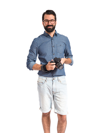 Young hipster man with his camera photo