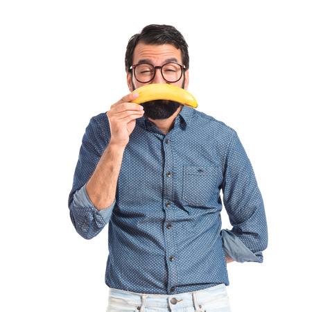 Sad young hipster man with banana photo