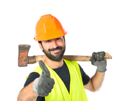 Workman with ax over white background photo