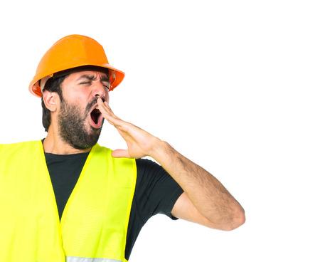 Workman yawning over isolated white background photo