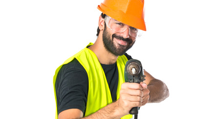 workman with drill over white background photo