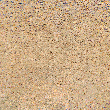textured wall: Brown rough textured wall Stock Photo