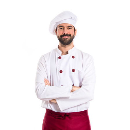 cocinero italiano: Cocinero con los brazos cruzados sobre el fondo blanco