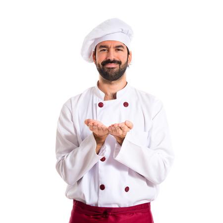 Chef holding something over white background photo