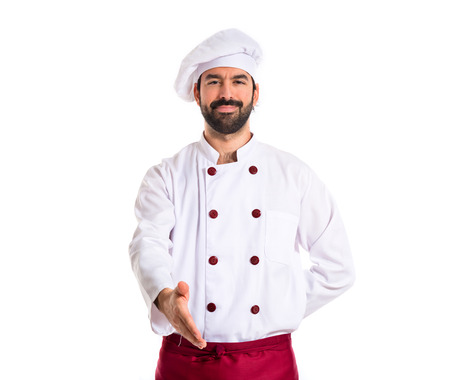 Chef making a deal over white background photo