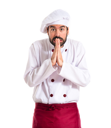Chef pleading over white background