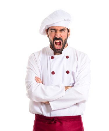 angry: Angry chef shouting over white background Stock Photo