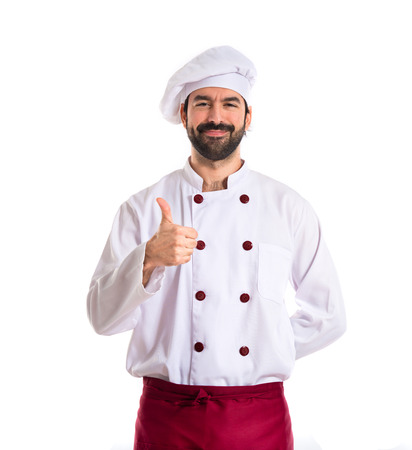 Chef with thumb up over white background photo