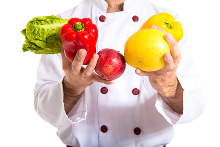 Chef holding vegetables photo