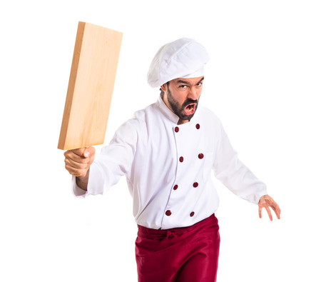 kitchen tool: Chef attacking with kitchen tool Stock Photo