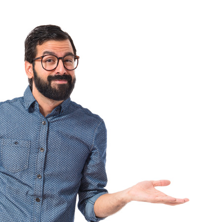 Young hipster man having doubts over white background Standard-Bild