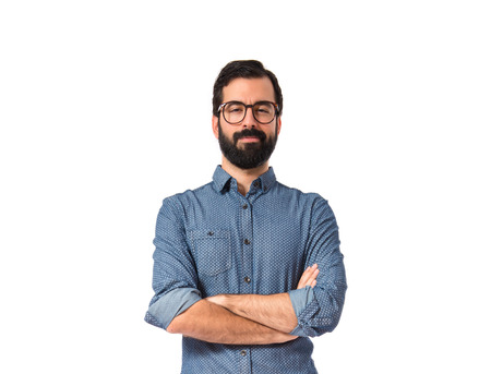 man with glasses: Young hipster man with his arms crossed Stock Photo