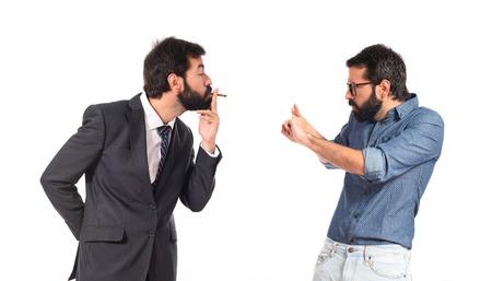 Businessman smoking over isolated white background photo