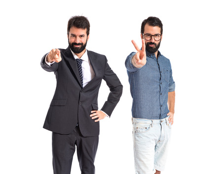 Twin brothers doing victory gesture photo