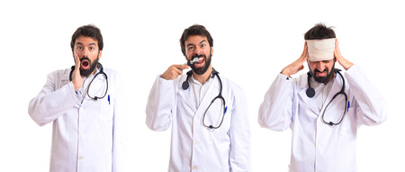 Crazy otorhinolaryngologist with his otoscope over white background photo