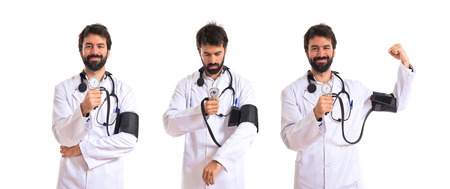 Strong doctor with blood pressure monitor over white background photo