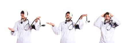 Crazy doctor over white background photo