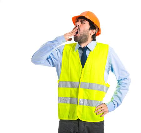Workman yawning over white background photo