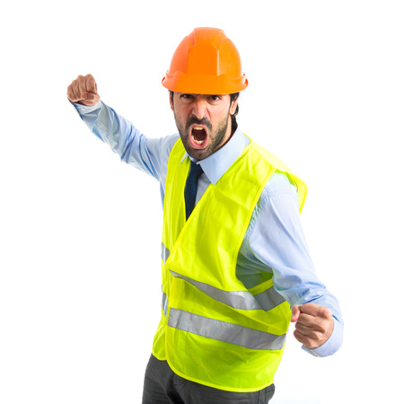 Workman giving punch over white background photo