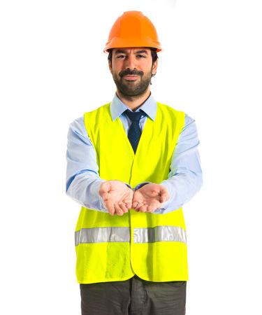 workman holding something over white background photo